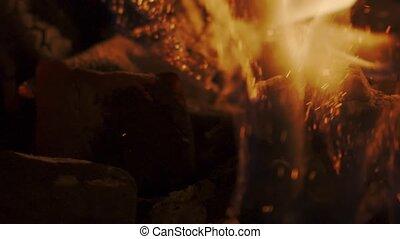 Stiring charcoal. Slow motion shot on Red camera - Stiring ...