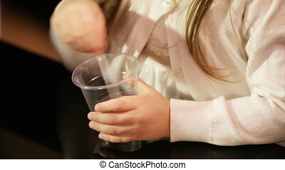 Stirring - Child stirs in a plastic beaker chemical liquid