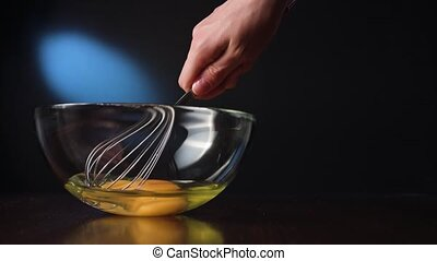 Stirring Eggs in a Glass Bowl with a Whisker - Stirring eggs...