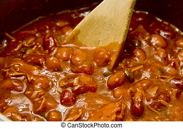 Stirring Hot Chili - Stirring a pot of hot chili with a...
