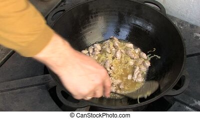 Stirring pieces of meat