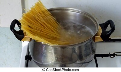 Stirring spaghetti in a boiling water