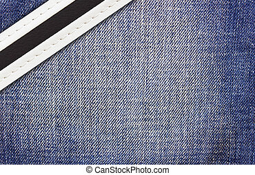 stitched leather on jeans background, closeup view