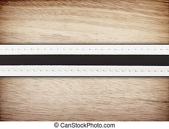 stitched leather on wooden background.