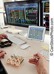 Stock brokers eating sushi