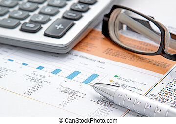 Stock chart with calculator, pen and eyeglasses