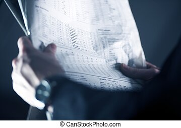 Stock Exchange News. Businessman with Stock Newspaper in His...