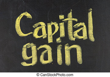 Stock Exchange strategy word CAPITAL GAIN made with chalk on a blackboard.
