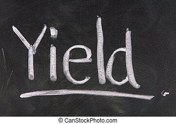 Stock Exchange strategy word YIELD made with chalk on a blackboard.