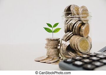 Stock financial indices with stack coin and calculator. Financial stock market in accounting market economy analysis.