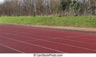 Woman running at track and field competition - Stock Footage...