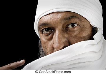 Arab Man - Stock image of Arab Man with turban over black...