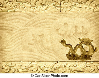 Stock image of stone carving of dragon on the wall.