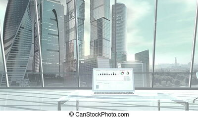On a laptop standing in a large office with skyscrapers on the background, stock exchange infographics are displayed