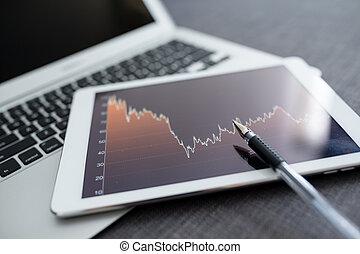 Stock market analyze with digital tablet