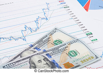Stock market chart with 100 USA dollars banknote - studio shot