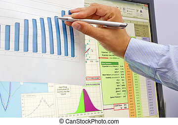 Stock market charts and graphs with pan on hand
