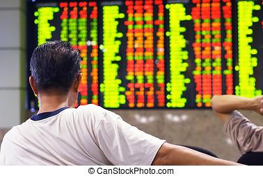 Stock market index - Asian man watching stock market index