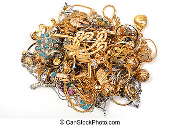 Gold jewelry on white Pile of gold jewelry isolated on picture