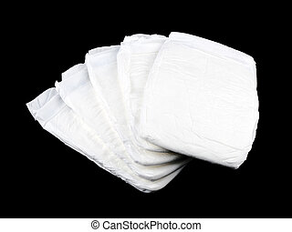 Stock of white diapers on black