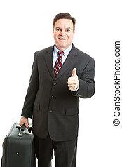 Stock Photo of Business Traveler Thumbsup