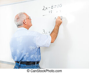 Stock Photo of Teacher or Adult Student at Blackboard