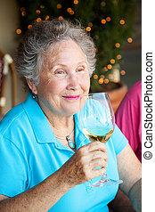 Stock Photo of Wine Tasting - Senior Woman