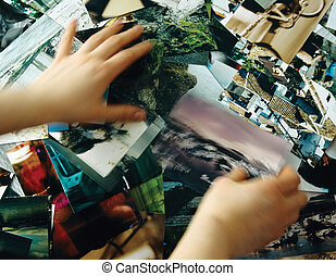 Stock photo search - Hands looking for a specific image in a...