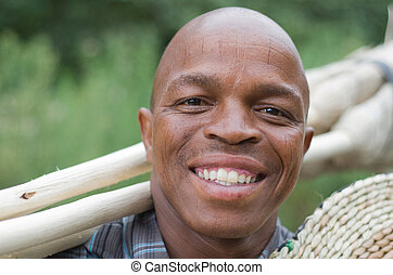 Stock photograph of a smiling South African entrepreneur small business broom salesman