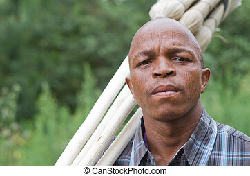 Stock photograph of a worried South African entrepreneur small business broom salesman