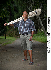 Stock photograph of South African entrepreneur small business broom salesman