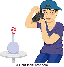 Stock Photographer - Young stock photographer taking a photo...