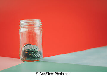 Stock Thai coin (baht) in clear glass jar. Save money or investment financial for future concept.