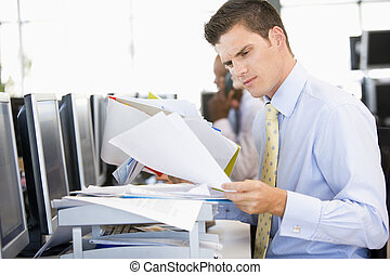 Stock Trader Looking Though Paperwork