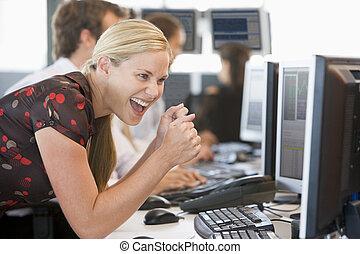 Stock Trader Overjoyed Looking At Monitor