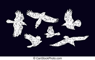 Stock vector set of soaring birds silhouettes with rough texture