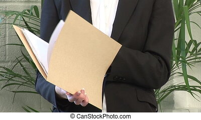Business woman examining a Document