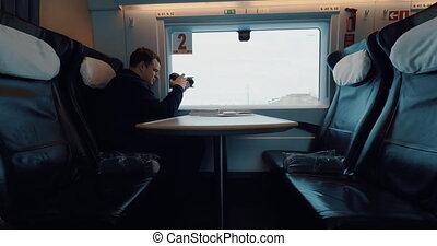 Stocker enjoying train ride after doing the job - Man...