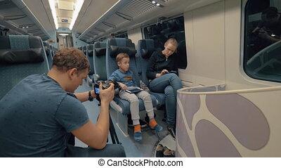 Stocker making footage of family train journey
