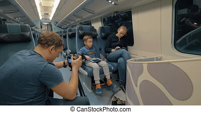 Stocker making footage of family train journey - Man stocker...