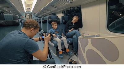 Stocker making footage of family train journey - Man stocker...