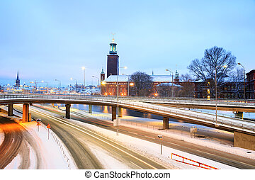 Stockholm Cityhall at dusk with transportation light trail...