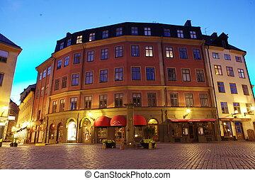 Stockholm Old Town street illuminated at night