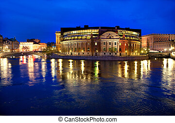 Stockholm parliament building at night, with old town and...