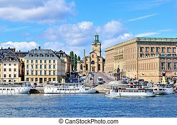 Stockholm. Quay Skeppbrokajen and Stockholm?s Cathedral (Storkyrkan, the oldest in the city)