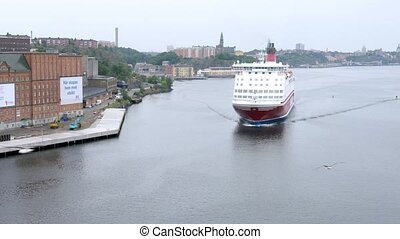 VIKING LINE cruise liner pass in front of city