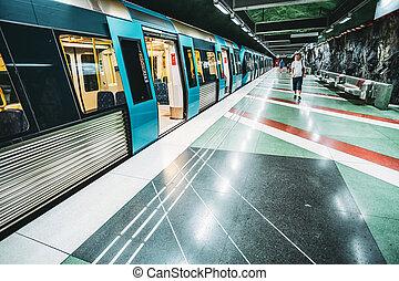 Stockholm, Sweden. Man Walking Near Train In Metro Underground Subway Station