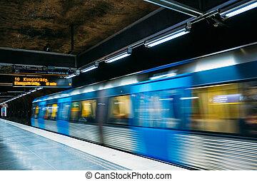 Stockholm Sweden. Modern Illuminated Metro Underground Subway Station With Moving Blue Gray Train