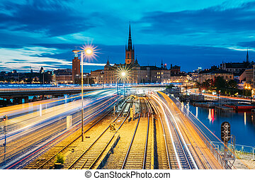 Stockholm, Sweden. Scenic View Of Stockholm Skyline At Summer Evening. Famous Popular Destination Scenic Place. Riddarholm Church And Subway Railway