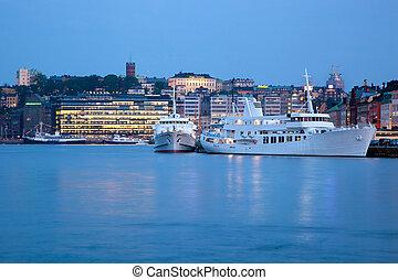 Stockholm, Sweden waterfront at night - Stockholm, Sweden at...